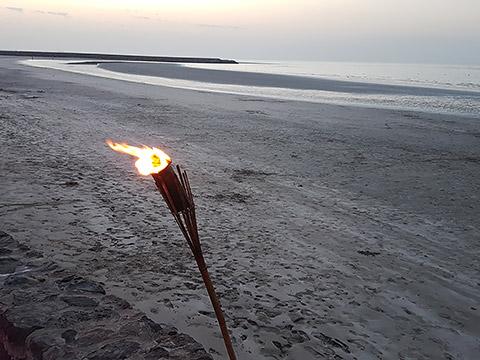 Fackel am Strand